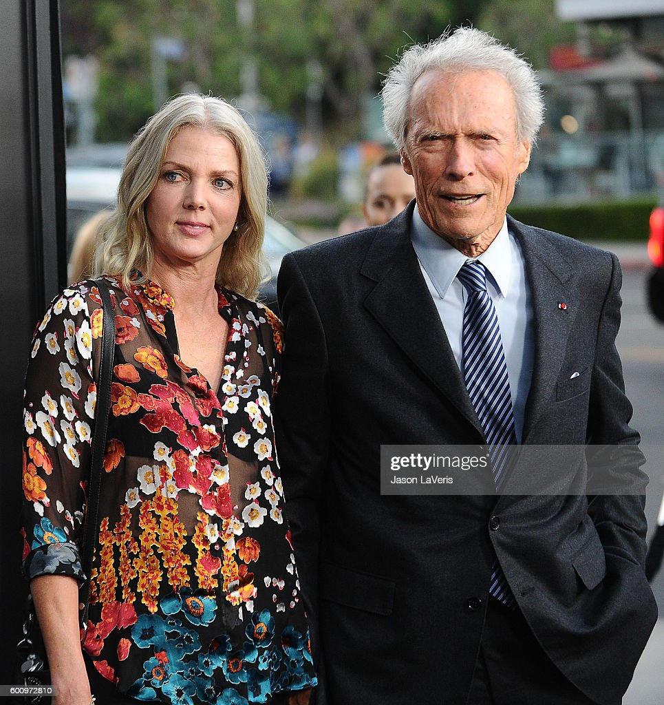 Director Clint Eastwood and Christina Sandera attend a screening of 'Sully' at Directors Guild Of America on September 8, 2016 in Los Angeles, California.