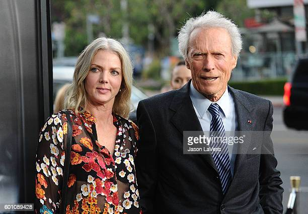 "Director Clint Eastwood and Christina Sandera attend a screening of ""Sully"" at Directors Guild Of America on September 8, 2016 in Los Angeles,..."