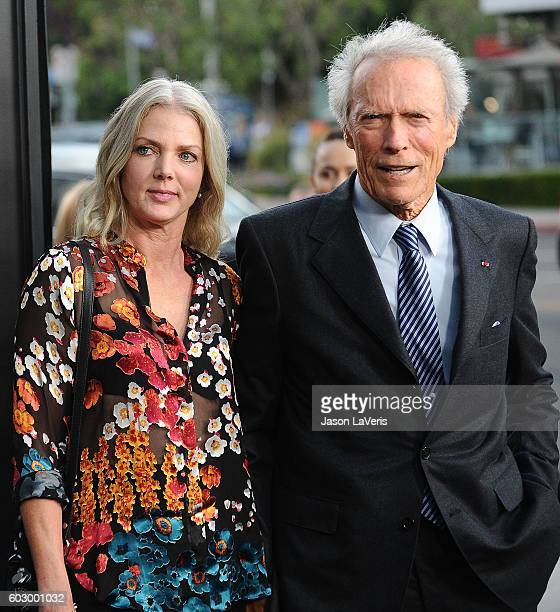 Director Clint Eastwood and Christina Sandera attend a screening of Sully at Directors Guild Of America on September 8 2016 in Los Angeles California
