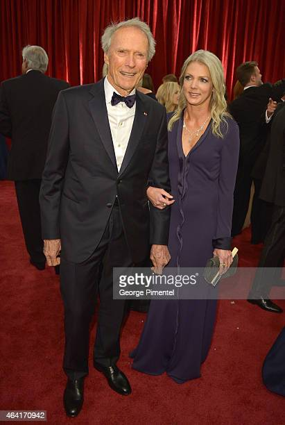 Director Clint Eastwood and Christina Sandera attend the 87th Annual Academy Awards at Hollywood & Highland Center on February 22, 2015 in Hollywood,...