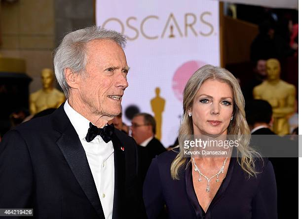 Director Clint Eastwood and Christina Sandera attend the 87th Annual Academy Awards at Hollywood Highland Center on February 22 2015 in Hollywood...