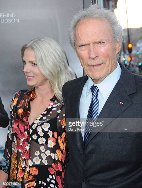 Director Clint Eastwood and Christina Sandera attend the Los Angeles industry screening of Warner Bros Pictures' 'Sully' at Directors Guild Of...