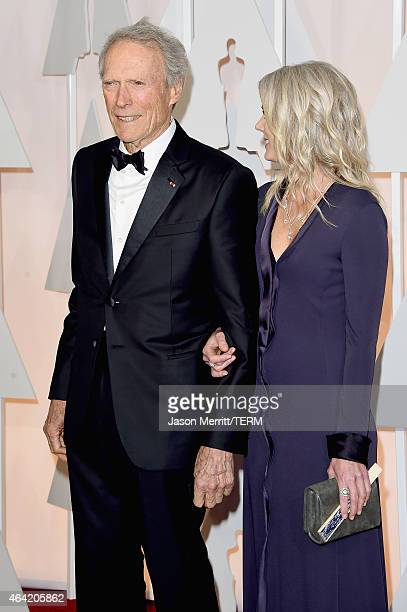Director Clint Eastwood and Christina Sandera attends the 87th Annual Academy Awards at Hollywood Highland Center on February 22 2015 in Hollywood...