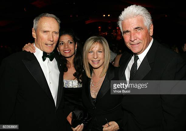 Director Clint Eastwood Dina Ruiz Eastwood Barbra Streisand and James Brolin attend the Governors Ball after the 77th Annual Academy Awards at the...