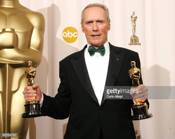 Director Clint Eastwood poses with his Oscar award for Best Director in Million Dollar Baby backstage during the 77th Annual Academy Awards on...