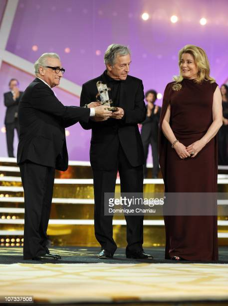 """Director Costa Gavras awarded """"golden star"""" by Martin Scorcese L) and actress Catherine Deneuve during the 10 th Marrakech Film Festival on December..."""