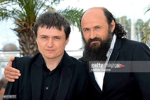 Director Cristian Mungiu and Actor Valeriu Andriuta pose at the 'Dupa Dealuri' photocall during the 65th Annual Cannes Film Festival at Palais des...
