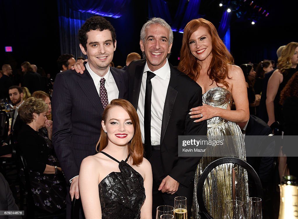 Director Damian Chazale (L), and actress Emma Stone, Scott Mantz and Andrea Sabesin attend The 22nd Annual Critics' Choice Awards at Barker Hangar on December 11, 2016 in Santa Monica, California.