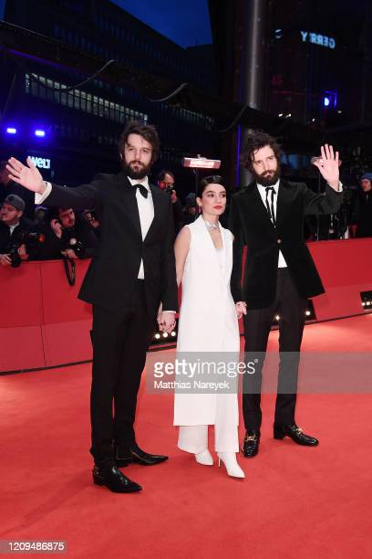 Director Damiano D'Innocenzo his brother director Fabio D'Innocenzo and a gust arrive for the closing ceremony of the 70th Berlinale International...