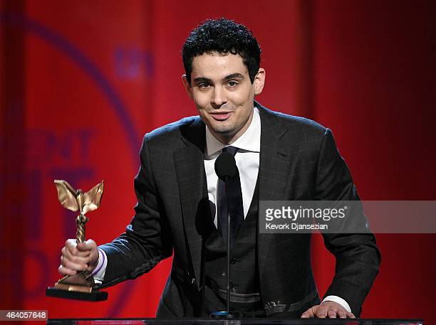 Director Damien Chazelle accepts Best Editing for 'Whiplash' on behalf of film editor Tom Cross onstage during the 2015 Film Independent Spirit...