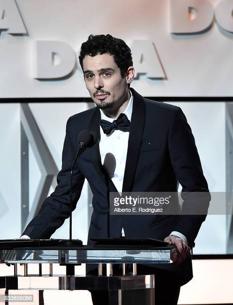 """Director Damien Chazelle accepts the Feature Film Nomination Plaque for """"La La Land"""" onstage during the 69th Annual Directors Guild of America Awards..."""