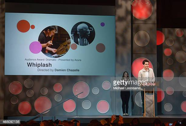 """Director Damien Chazelle accepts the Grand Jury Prize Dramatic for the film """"Whiplash"""" onstage at the Awards Night Ceremony at Basin Recreation Field..."""