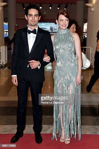 Director Damien Chazelle and actress Emma Stone attend the opening ceremony during the 73rd Venice Film Festival at Sala Grande on August 31 2016 in...