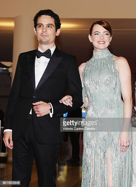 Director Damien Chazelle and actress Emma Stone attend the opening ceremony and premiere of 'La La Land' during the 73rd Venice Film Festival at Sala...