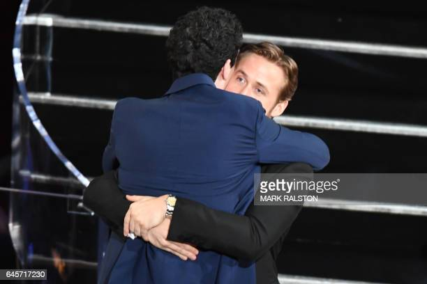 TOPSHOT US director Damien Chazelle celebrates with nominee for Best Actor in 'La La Land' Ryan Gosling after he won the Best Director award for 'La...