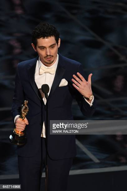 Director Damien Chazelle delivers a speech on stage after he won the Best Director award for 'La La Land'at the 89th Oscars on February 26 2017 in...