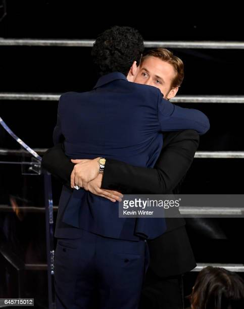 Director Damien Chazelle embraces actor Ryan Gosling after winning Best Director for 'La La Land' during the 89th Annual Academy Awards at Hollywood...
