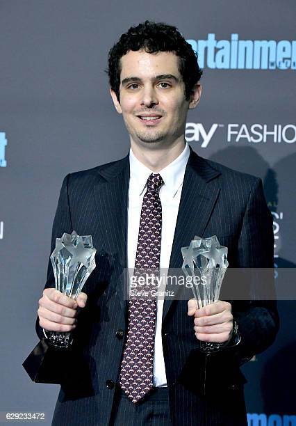 Director Damien Chazelle poses in the press room after winning the award for Best Director for the film 'La La Land' during The 22nd Annual Critics'...