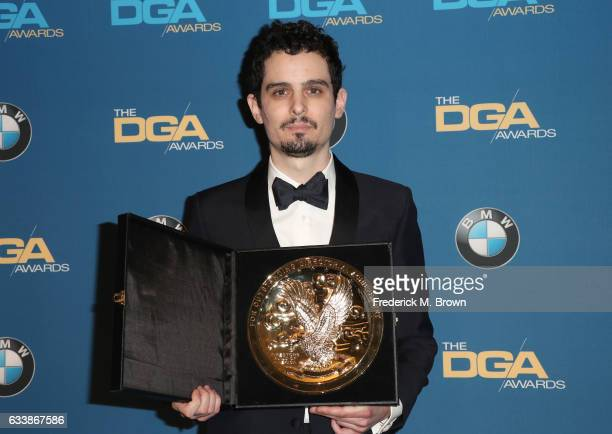 Director Damien Chazelle winner of the Outstanding Directorial Achievement in Feature Film for 2016 award for 'La La Land' poses in the press room...