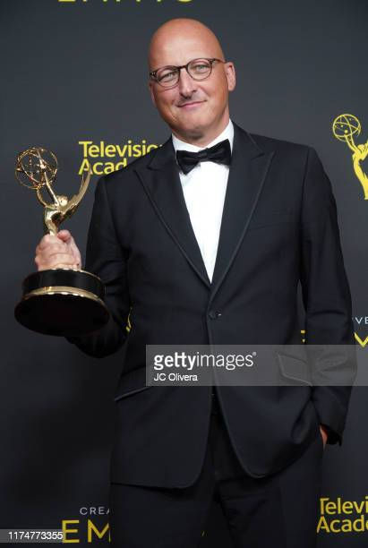 Director Dan Reed poses in the press room with the award for outstanding documentary or nonfiction special for Leaving Neverland' during the 2019...