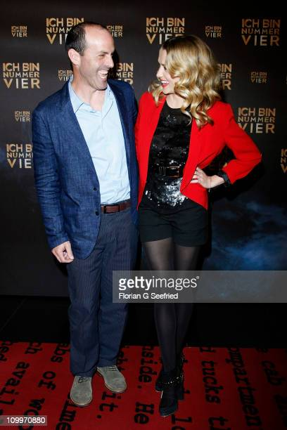 Director Daniel John 'DJ' Caruso and actress Teresa Palmer attend the Germany Premiere of 'I Am Number Four' at CineStar at Sony Center on March 11...