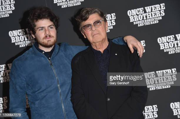 """Director Daniel Roher and Robbie Robertson attend the New York premiere of """"Once Were Brothers: Robbie Robertson And The Band"""" at Walter Reade..."""
