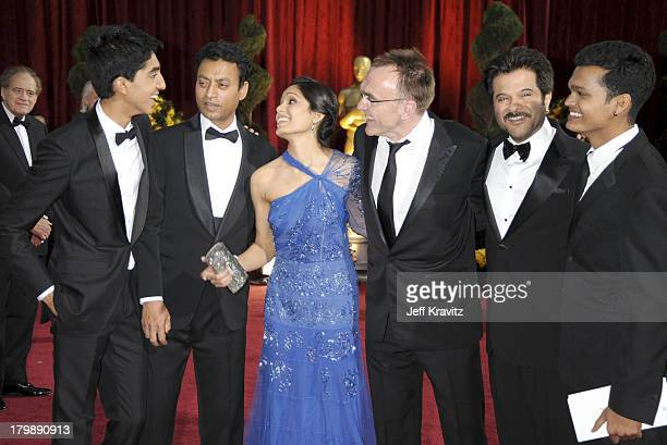 Director Danny Boyle and actors Dev Patel, Irrfan Khan, Freida Pinto, Anil Kapoor, and Madhur Mittal arrives at the 81st Annual Academy Awards held...