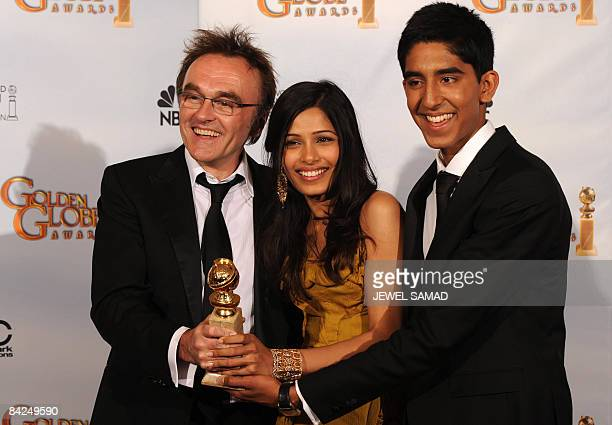 Director Danny Boyle and actors Freida Pinto and Dev Patel hold the award for Best Motion PictureDrama for 'Slumdog Millionaire' in the press room at...