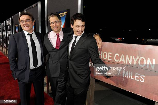 Director Danny Boyle Fox Filmed Entertainment Cochairman and CEO Tom Rothman and actor James Franco arrive at the premiere of Fox Searchlight...