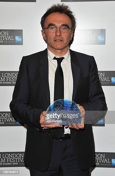 Director Danny Boyle poses with the BFI Fellowship Award in the press room during the BFI London Film Festival Awards Ceremony as part of the 54th...