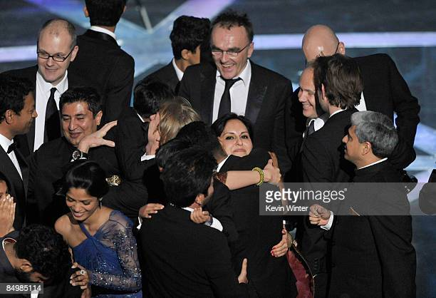 Director Danny Boyle with cast and crew celebrate 'Slumdog Millionaire' winning the Best Picture award during the 81st Annual Academy Awards held at...
