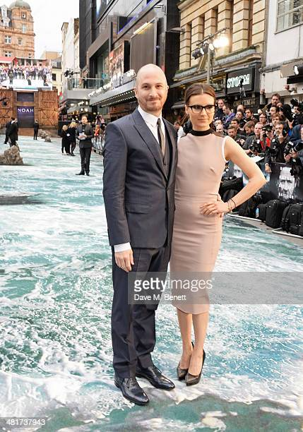 Director Darren Aronofsky and BrandiAnn Milbradt attend the UK Premiere of 'Noah' at Odeon Leicester Square on March 31 2014 in London England