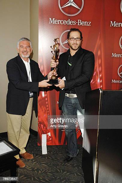 Director Darryl Macdonald presents Elliot Kotek with the New Voices/New Visions Award on behalf of the film Hounds at the 19th Annual Palm Springs...