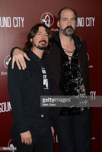 Director Dave Grohl and musician Krist Novoselic arrive at the premiere of 'Sound City' at ArcLight Cinemas Cinerama Dome on January 31, 2013 in...