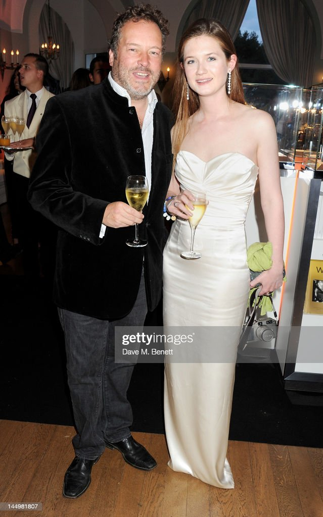 Director David Allain (L) and actress Bonnie Wright attend the IWC and Finch's Quarterly Review Annual Filmmakers Dinner at Hotel Du Cap-Eden Roc on May 21, 2012 in Antibes, France.