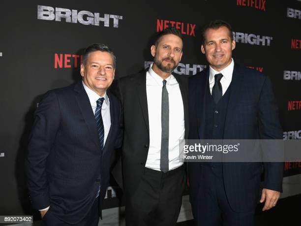 Director David Ayer Chief Content Officer for Netflix Ted Sarandos and Scott Stuber attend the Premiere Of Netflix's 'Bright' at Regency Village...