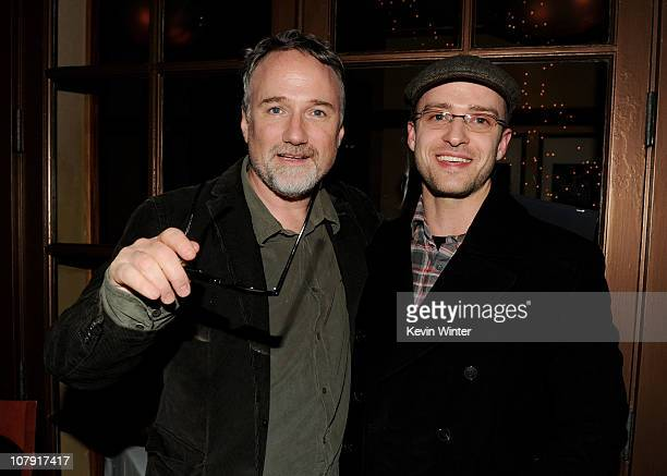 Director David Fincher and actor/singer Justin Timberlake pose at Sony Pictures Home Entertainment's 'The Social Network' Bluray DVD launch party at...