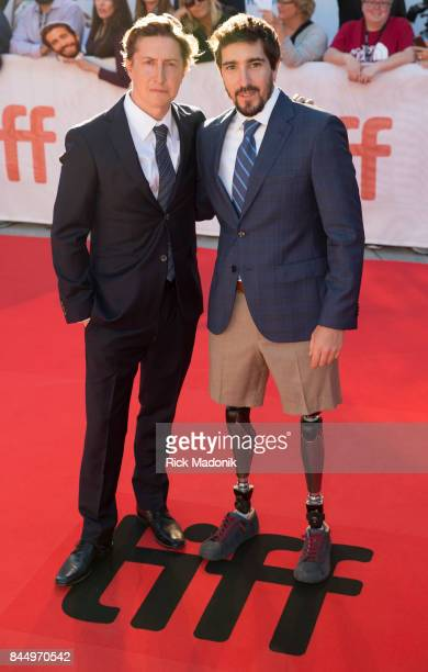 Director David Gordon Green and coauthor of the book Jeff Bauman TIFF red carpet outside Roy Thomson for the screening of STRONGER starring Jake...