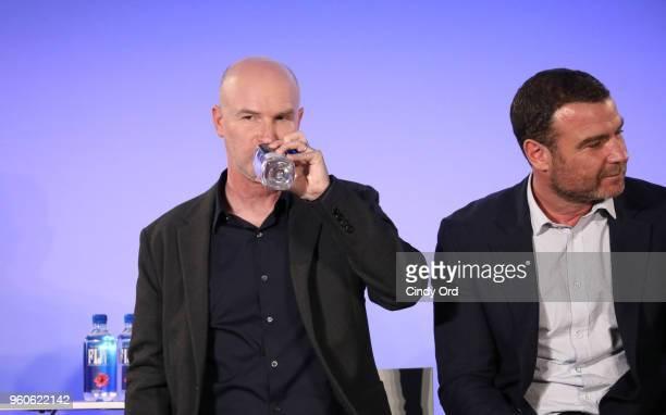 Director David Hollander of Ray Donovan drinks Fiji water onstage during the Fix This Ray Donovan panel Day Two of the Vulture Festival Presented By...