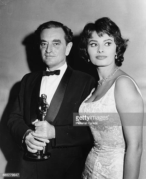 Director David Lean holding his Oscar for the film 'The Bridge on the River Kwai', with presenter Sophia Loren, at the 30th Academy Awards, Los...