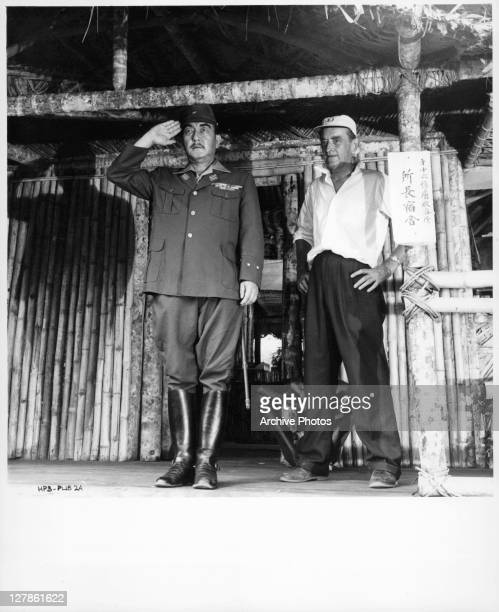 Director David Lean watches unidentified actor salute for the film 'The Bridge On The River Kwai', 1957.