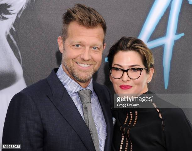 Director David Leitch and Kelly McCormick arriveat the premiere of Focus Features' 'Atomic Blonde' at The Theatre at Ace Hotel on July 24 2017 in Los...