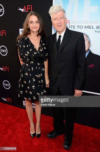 Director David Lynch and actress Emily Stofle attend AFI's 41st Life Achievement Award Tribute to Mel Brooks at Dolby Theatre on June 6 2013 in...