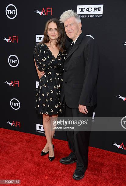 Director David Lynch and actress Emily Stofle attend AFI's 41st Life Achievement Award Tribute to Mel Brooks at Dolby Theatre on June 6, 2013 in...