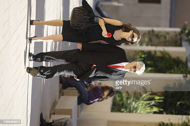 Director David Lynch and his wife arrive the funeral for Italianborn film producer Dino De Laurentiis at the Cathedral of Our Lady of the Angels on...