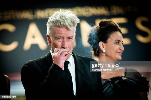 Director David Lynch smokes as he departs the 'Twin Peaks' screening during the 70th annual Cannes Film Festival at Palais des Festivals on May 25...