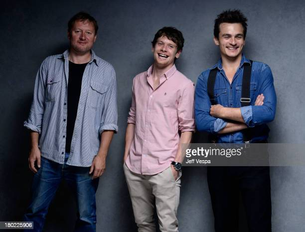 Director David Mackenzie actor Jack O'Connell and actor Rupert Friend 'Starred Up' pose at the Guess Portrait Studio during 2013 Toronto...