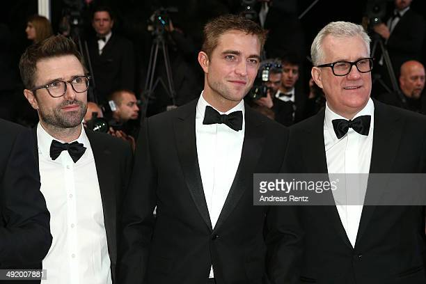 Director David Michod actor Robert Pattinson and producer David Linde attend 'The Rover' premiere during the 67th Annual Cannes Film Festival on May...