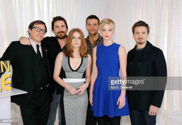 Director David O Russell actors Amy Adams Christian Bale Jennifer Lawrence Bradley Cooper and Jeremy Renner attend American Hustle Cast Photo Call at...