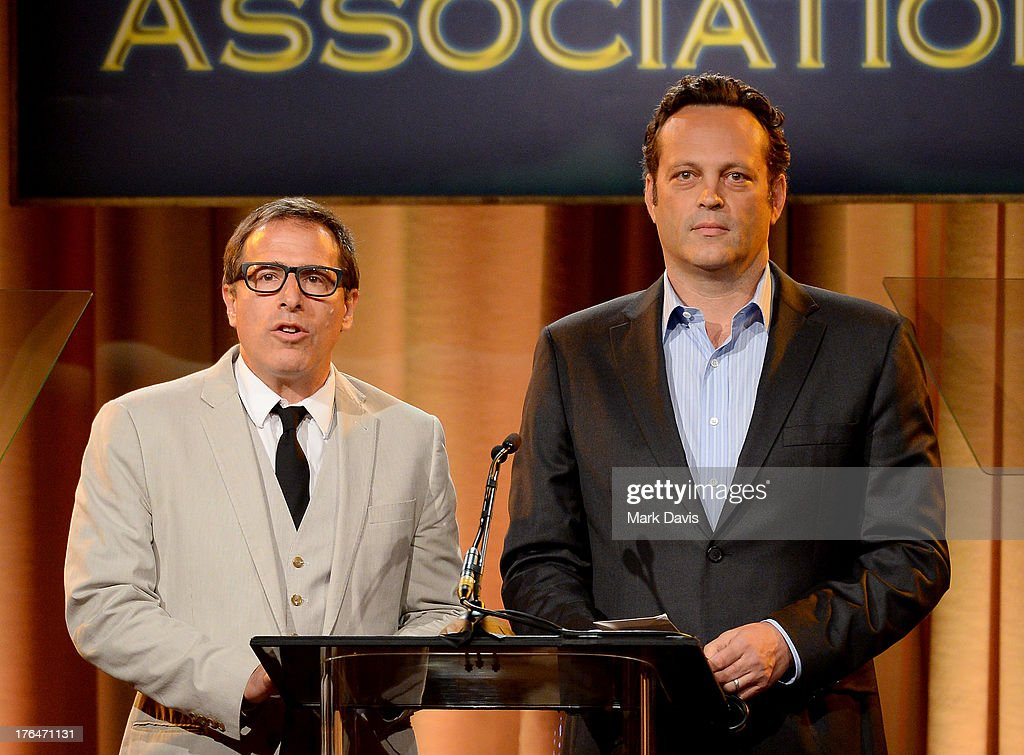Director David O. Russell and actor Vince Vaughn speak onstage at the Hollywood Foreign Press Association's 2013 Installation Luncheon at The Beverly Hilton Hotel on August 13, 2013 in Beverly Hills, California.